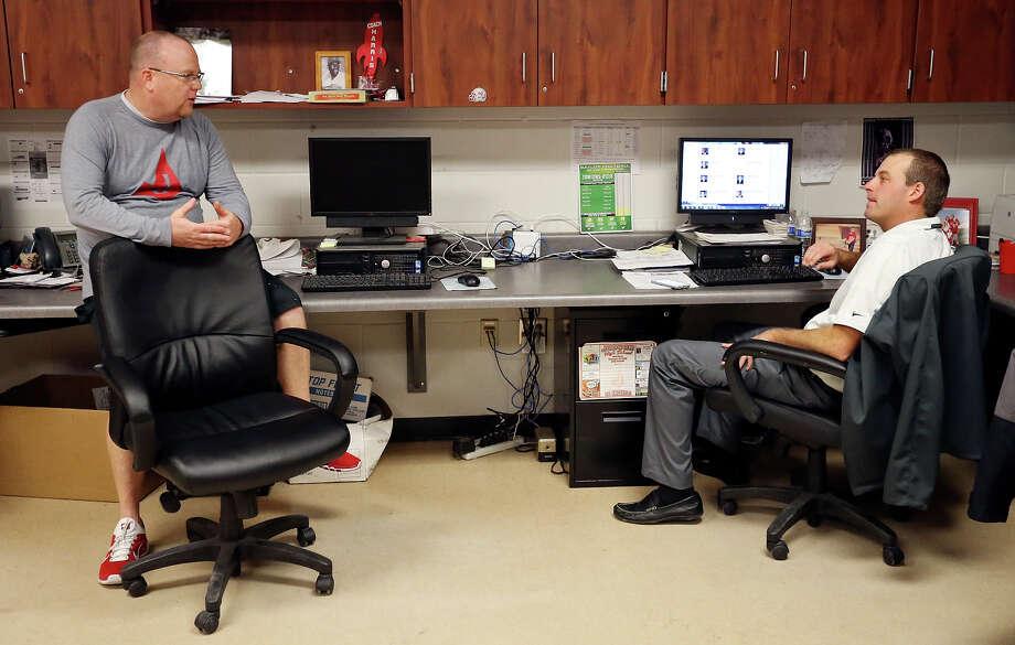 Judson high school head football coach Sean McAuliffe (left) talks with assistant football coach and recruiting coordinator Joel Call Friday Jan. 16 , 2015 in his office at the school. Photo: Edward A. Ornelas, Staff / San Antonio Express-News / © 2015 San Antonio Express-News