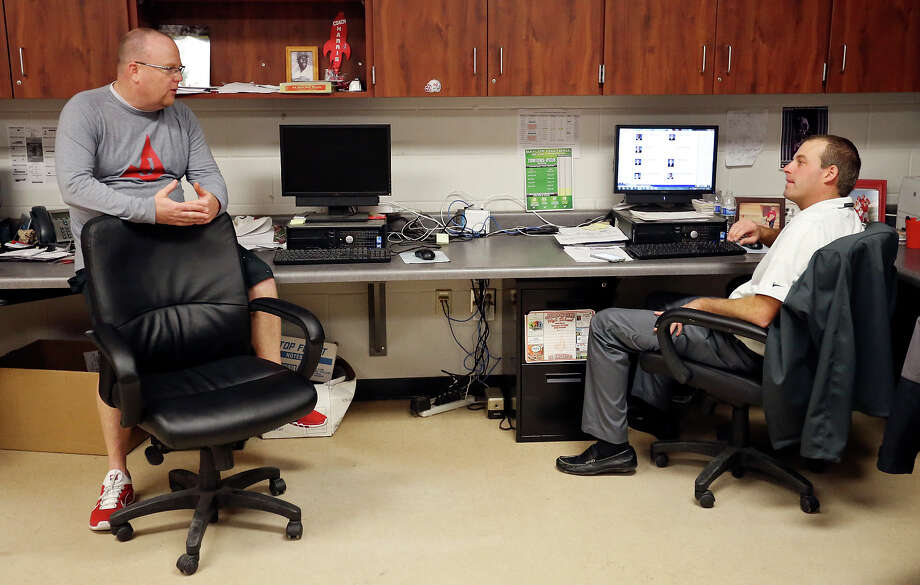 Judson high school head football coach Sean McAuliffe (left) talks with assistant football coach and recruiting coordinator Joel Call Friday Jan. 16 , 2015 in his office at the school. Photo: Edward A. Ornelas, Staff / San Antonio Express-News / © 2015 San Antonio Express-News