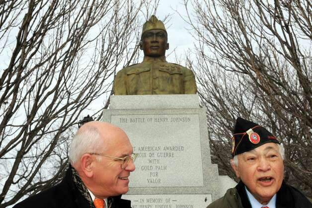 Congressman Paul Tonko (D-NY), left, announced at the Henry Johnson Memorial that Dr. Maurice Thornton, right, would be his guest at the 2015 State of the Union address in Washington, D.C. at Washington Park on Saturday Jan. 17, 2015 in Albany, N.Y.  Dr. Thornton, a native of Delmar, retired adjunct professor and veteran of the Korean War is also a leading member of the 369th VeteranOs Association, a group dedicated to preserving and sharing the story of the all-African American 369th Infantry Regiment, known as the Harlem Hell-fighters. (Michael P. Farrell/Times Union) Photo: Michael P. Farrell / 00030237A