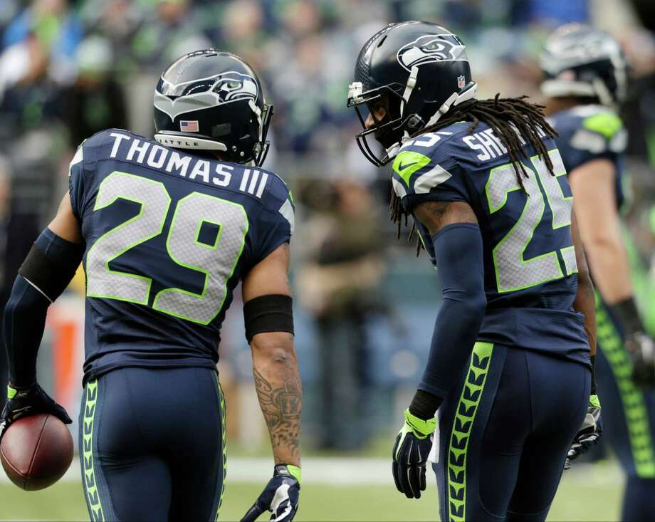 Without an elite quarterback, building a championship-level defense - as the Seahawks did with secondary stalwarts Earl Thomas, left, and Richard Sherman - is job one for Texans general manager Rick Smith. Photo: John Froschauer, FRE / FR74207 AP