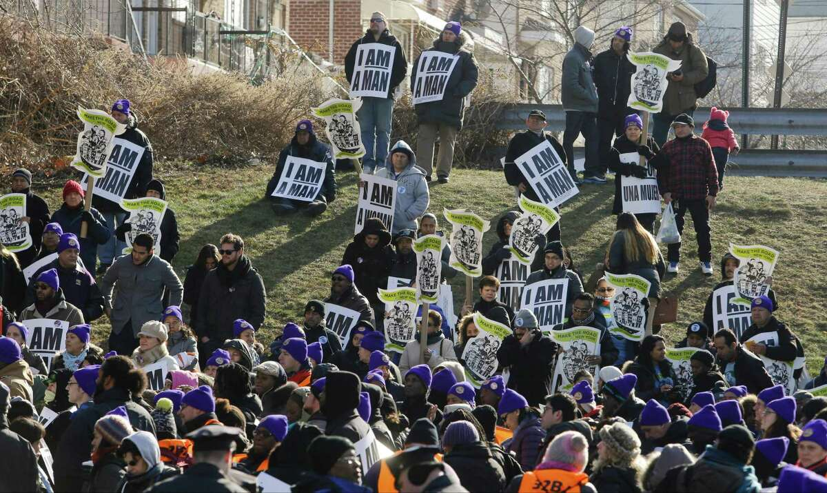 Protesters gather on Martin Luther King's birthday during a rally to support airport workers near LaGuardia airport Thursday, Jan. 15, 2015, in New York. (AP Photo/Frank Franklin II) ORG XMIT: NYFF101