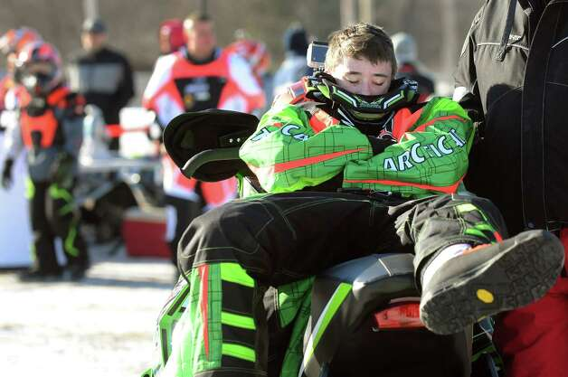 Michael Newman, 15, of Stamford, Conn. relaxes in the sun as he waits to compete in junior classes during East Coast Snocross on Saturday, Jan. 17, 2015, at Schaghticoke Fair Grounds in Schaghticoke, N.Y. The event continues Sunday with gates opening at 9 a.m. and finals concluding by 3:30 p.m. Admission is $15 for adults. Children age 7 and under are free with a paying adult. (Cindy Schultz / Times Union) Photo: Cindy Schultz / 00030250A