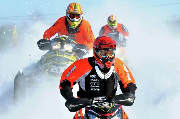 Snowmobilers compete during East Coast Snocross on Saturday, Jan. 17, 2015, at Schaghticoke Fair Grounds in Schaghticoke, N.Y. The event continues Sunday with gates opening at 9 a.m. and finals concluding by 3:30 p.m. Admission is $15 for adults. Children age 7 and under are free with a paying adult. (Cindy Schultz / Times Union) Photo: Cindy Schultz / 00030250A