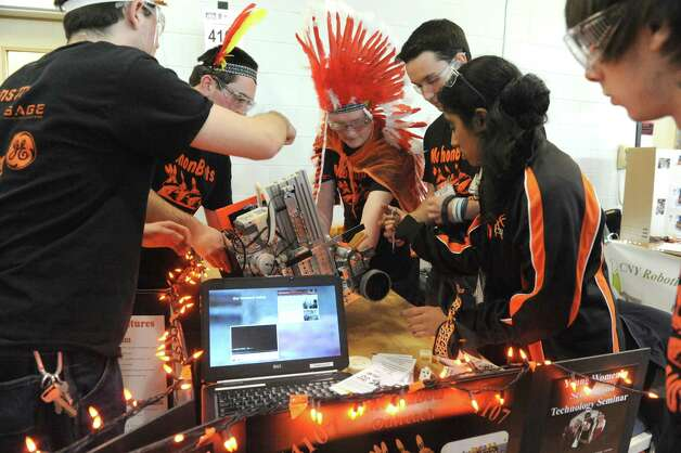 The Mohonasen High School  MohonBots team works on their robot during the Albany Academies hosted 2nd Annual Capital Region Empire New York FIRST Tech Challenge Tournament on Saturday Jan. 17, 2015 in Albany, N.Y. (Michael P. Farrell/Times Union) Photo: Michael P. Farrell / 00030249A