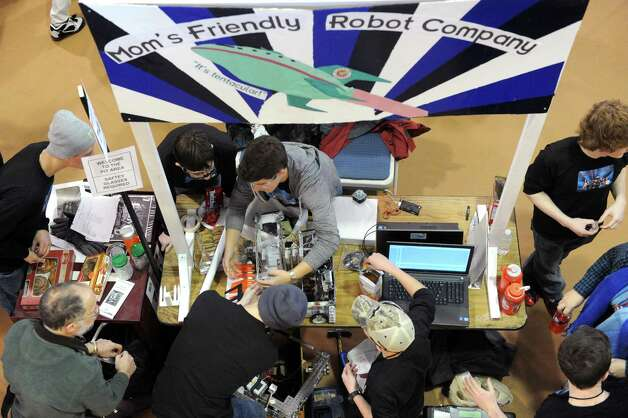 The Burnt Hills-Ballston Lake High School team Mom's Friendy Robot Company works on their robot during the Albany Academies hosted 2nd Annual Capital Region Empire New York FIRST Tech Challenge Tournament on Saturday Jan. 17, 2015 in Albany, N.Y. (Michael P. Farrell/Times Union) Photo: Michael P. Farrell / 00030249A