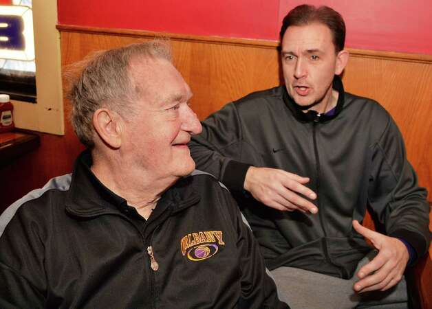 Longtime area basketball coach Don Bassett, left, and UAlbany men's basketball head coach Will Brown during their lunch break Tuesday Jan. 13, 2015, in Albany, N.Y.  (John Carl D'Annibale / Times Union) Photo: John Carl D'Annibale / 00030182A