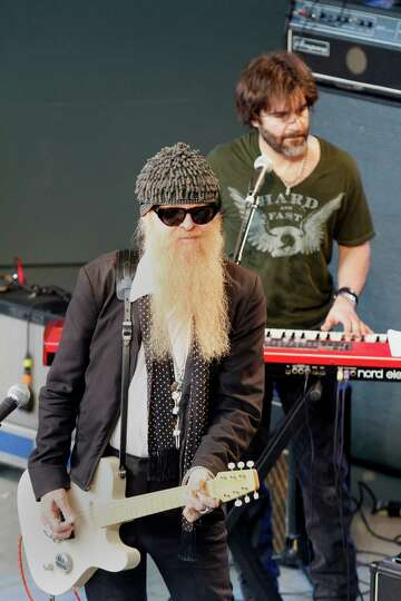 ZZ Top's Billy Gibons, foreground, plays with John Cusimano at Rachael Ray's Feedback side party d