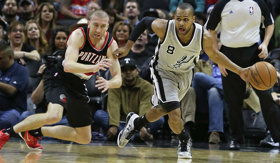Patty Mills grabs a steal from Steve Blake as the Spurs play the Portland Trailblazers at the AT&T Center on January 16, 2015. Photo: Tom Reel / San Antonio Express-News