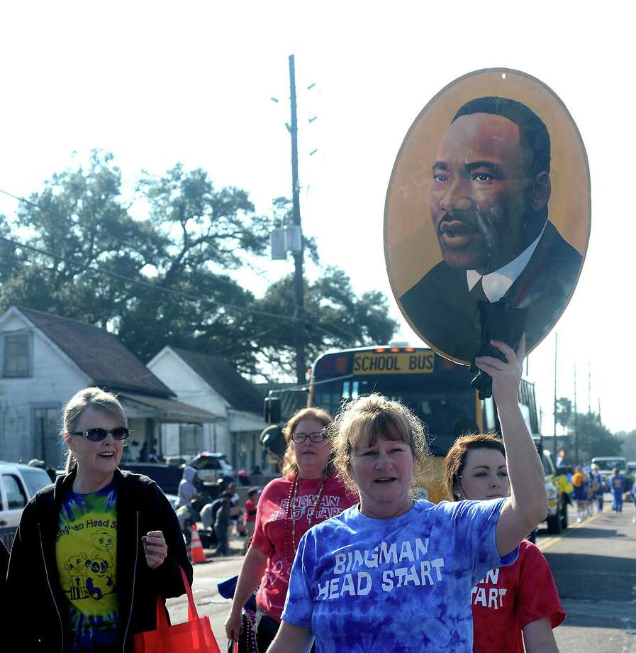 Bingman Head Start staff and students honor Dr. King as they march during the Martin Luther King, Jr., birthday parade through Beaumont Saturday morning. Schools, businesses, politicians and other community groups joined in the event, throwing out candy to the families lining the streets. 