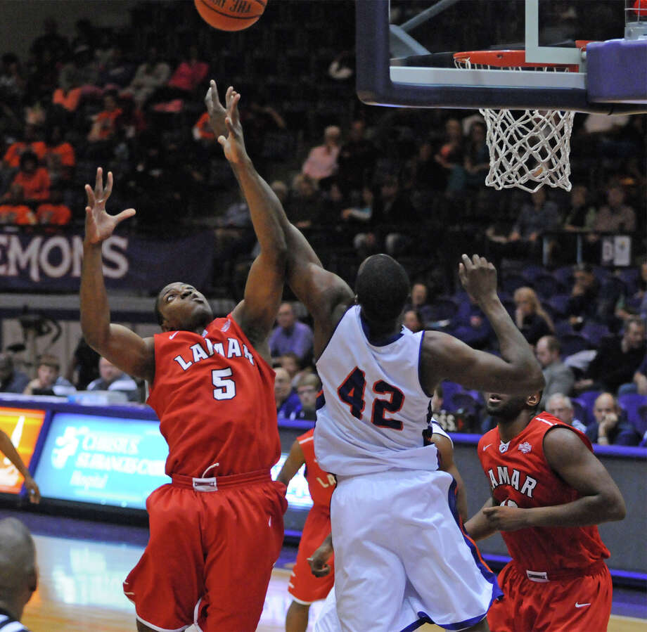 Lamar's Tyran de Lattibeaudiere (5) fights for a rebound with Northwestern State's Deji Adekunle (42) during Saturday's game. The Cardinals lost to the Demons 96-84. Photo courtesy of NSU Photo Lab