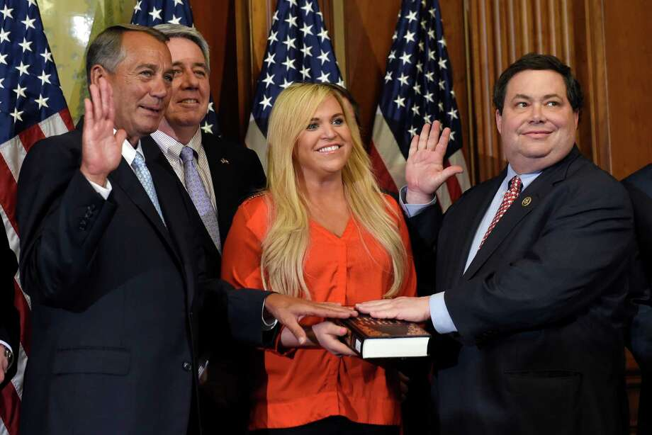 House Speaker John Boehner of Ohio poses for a photo with Rep. Blake Farenthold, R-Texas, right, accompanied by family, to re-enact the House oath-of-office, Tuesday, Jan. 6, 2015, on Capitol Hill in Washington. (AP Photo/Susan Walsh) Photo: Susan Walsh, STF / AP