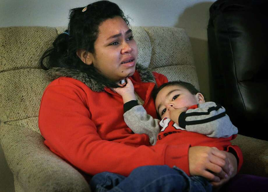 Alejandra's eyes well up with tears as she recalls seeing a 14 year-old boy dragged out of a cartel house with a rope around his neck after being killed. The 20 year-old Alejandra and her 2 year-old son Steven, immigrants from Honduras, were released from Karnes County Residential Center, a detention center, and given shelter by members of the Interfaith Welcome Coalition.  Alejandra and her two year-old were kidnapped in Mexico by members of a drug cartel and forced to work.  They and the group they were with, were rescued by Mexican law and military officials following a violent gun battle.  The young family is now on their way to be with relatives in the New England area.  Wednesday, Dec. 31, 2014. Photo: BOB OWEN, San Antonio Express-News / © 2014 San Antonio Express-News