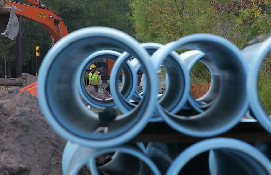 Burgeoning growth in Montgomery County has necessitated new water line construction by the San Jacinto River Authority, as seen by this pipe project last Novenber along Research Forest Drive in The Woodlands. Photo: Melissa Phillip, Staff / © 2013  Houston Chronicle