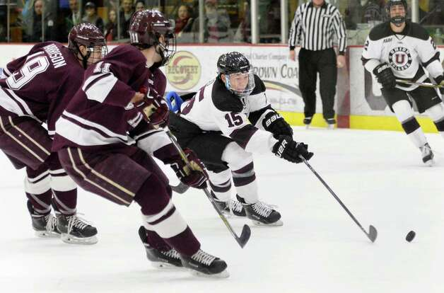 Union's #15,Spencer Foo, center, skates through Colgate defenders during Saturday night's game Jan. 17, 2015, in Schenectady, NY.  (John Carl D'Annibale / Times Union) Photo: John Carl D'Annibale / 00030185B