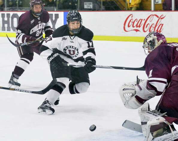 Union's #17 Daniel Ciampini, center, scores his second goal of the first period against Colgate goalie Charlie Finn, right, during Saturday night's game  Jan. 17, 2015, in Schenectady, NY.  (John Carl D'Annibale / Times Union) Photo: John Carl D'Annibale / 00030185B