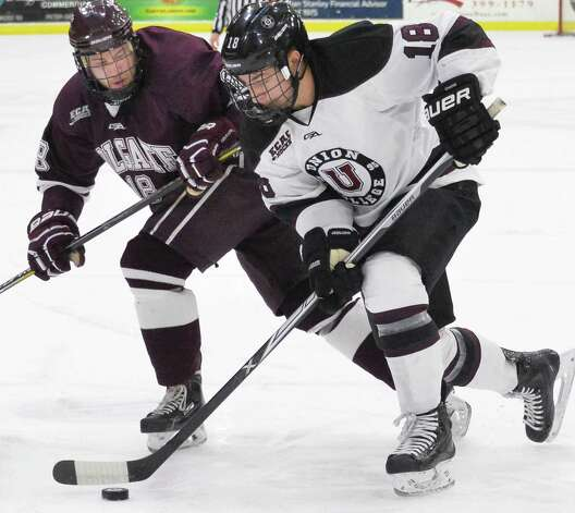 Union's #18 Max Novak, right, and Colgate's #18 Tylor Spink during Saturday night's game  Jan. 17, 2015, in Schenectady, NY.  (John Carl D'Annibale / Times Union) Photo: John Carl D'Annibale / 00030185B