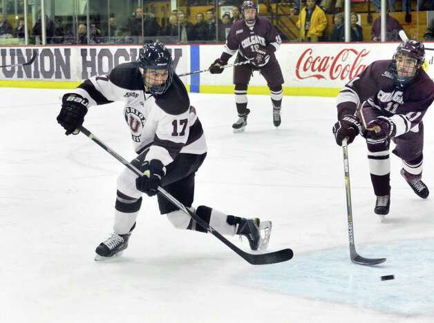 Union's #17 Daniel Ciampini, left, scores his first of two first period goals during Saturday night's game against Colgate Jan. 17, 2015, in Schenectady, NY.  (John Carl D'Annibale / Times Union) Photo: John Carl D'Annibale / 00030185B