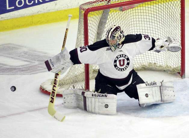 Union goalie #30 Colin Stevens stops a shot on goal during Saturday night's game against Colgate Jan. 17, 2015, in Schenectady, NY.  (John Carl D'Annibale / Times Union) Photo: John Carl D'Annibale / 00030185B