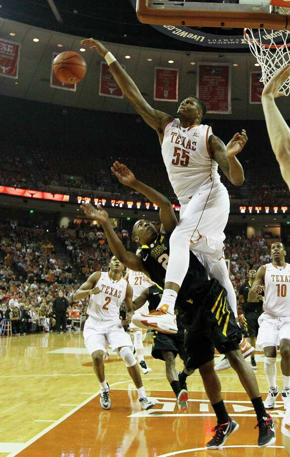 AUSTIN, TX - JANUARY 17: Cameron Ridley #55 of the Texas Longhorns blocks the shot by Jevon Carter #2 of the West Virginia Mountaineers at the Frank Erwin Center on January 17, 2015 in Austin, Texas. Photo: Chris Covatta, Getty Images / 2015 Getty Images