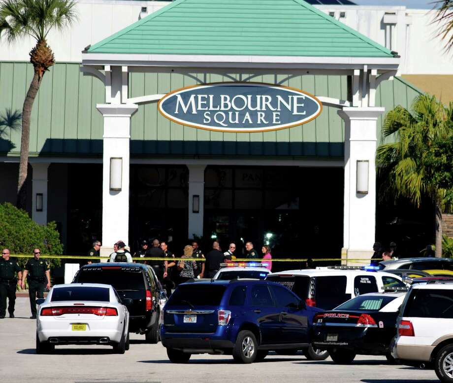 Emergency personnel respond to the scene of a fatal shooting rampage at the Melbourne Square Mall in Melbourne, Fla. Photo: Malcolm Denemark / Florida Today / Florida Today