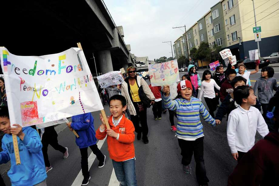 Students from E.R. Taylor Elementary march along Bayshore Boulevard during the annual King march. The police killings of two unarmed black men last year are on students' minds. Photo: Michael Short / Special To The Chronicle / ONLINE_YES