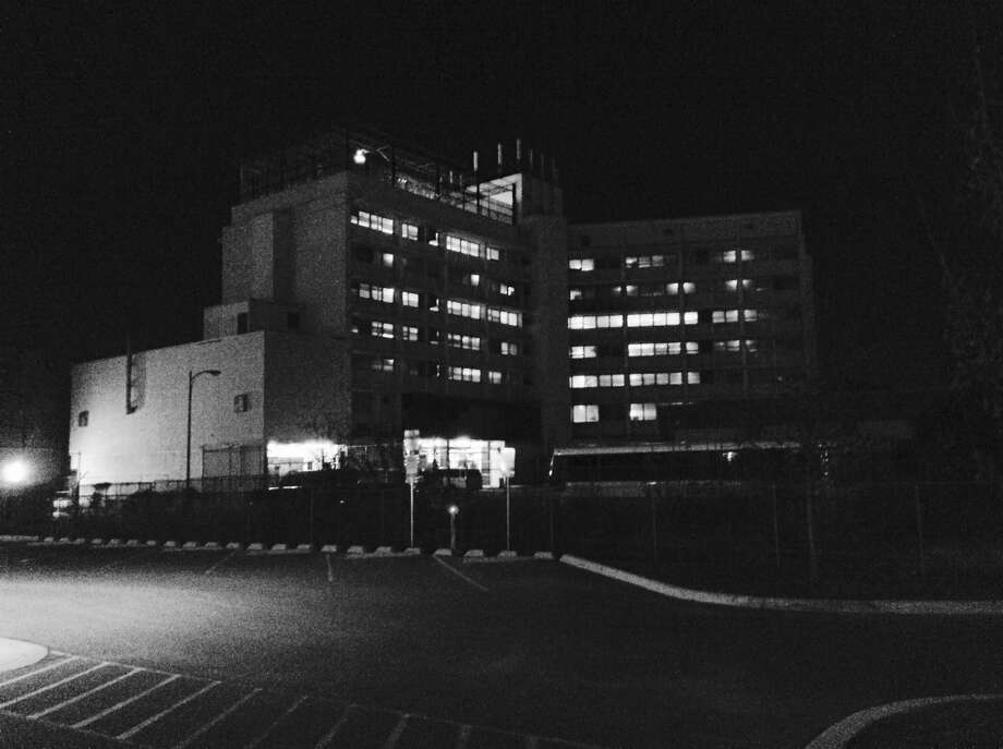 Once the Bexar County Jail, the Central Texas Detention Facility south of Dolorosa Street stands starkly in the darkness. Photo: Robert Kolarik, San Antonio Express-News