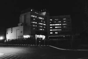 Once the Bexar County Jail, the Central Texas Detention Facility south of Dolorosa Street stands starkly in the darkness.