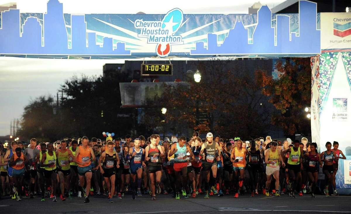 Marathoners go past the starting line during the beginning of the Houston Marathon, Sunday, January 18, 2015 in Houston.