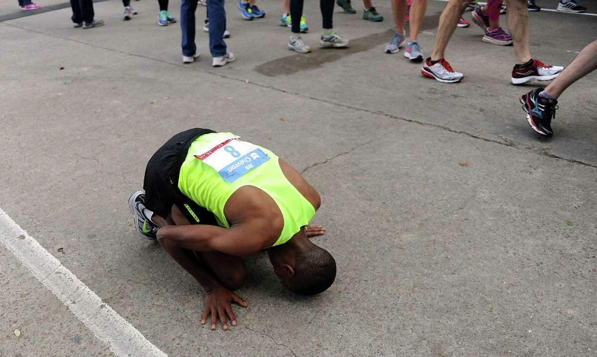 Houston Marathon champion Birhanu Gedefa of Ethiopia kisses the ground after his victory during the Houston Marathon, Sunday, January 18, 2015 in Houston.