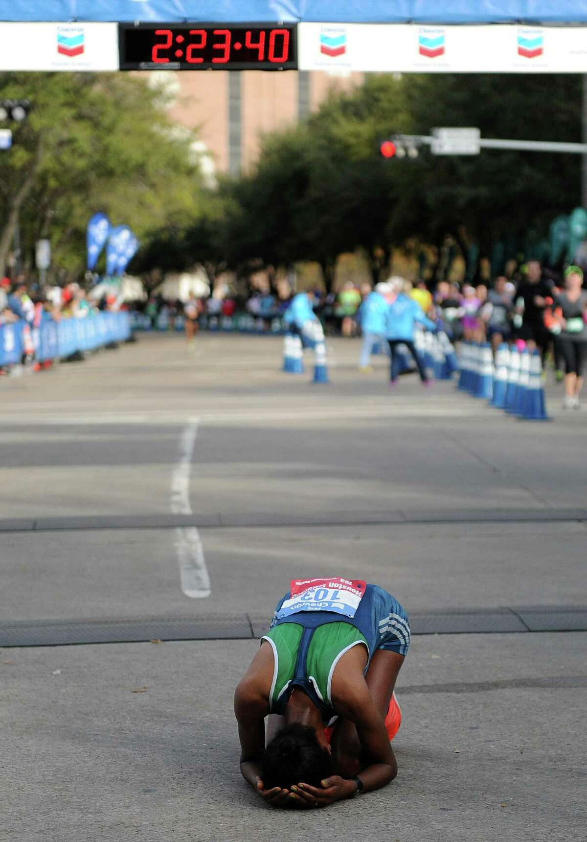 Guteni Imana of Ethipoia reacts after finishing in second place in the women's marathon during the Houston Marathon, Sunday, January 18, 2015 in Houston.