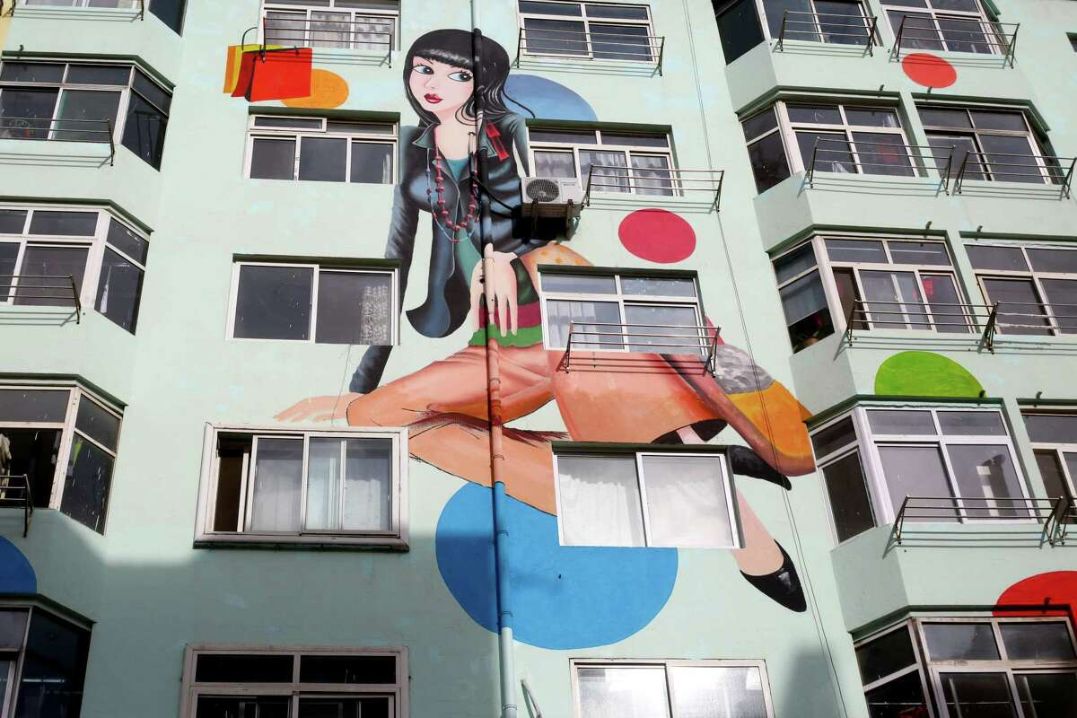 Wall paintings of 'sexy beauties' are seen on residential buildings on January 13, 2015 in Qingdao, Shandong province of China. Giant wall paintings which were painted 'sexy beauties' were shown on the residential buildings in east China's Shandong province, with a largest painting being at the height of seven-storeys.