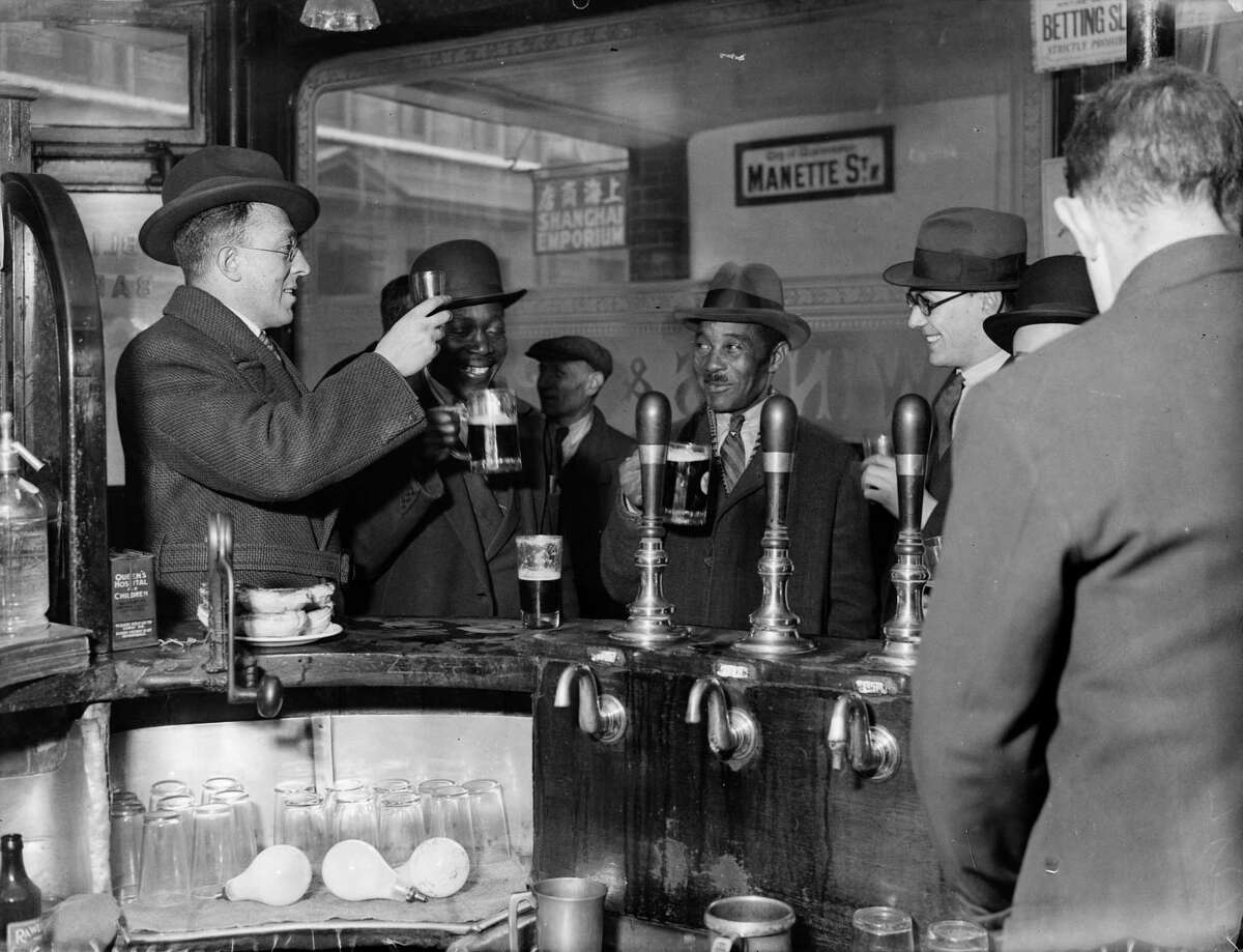 24th November 1933: Interior of a public house in London's Soho.