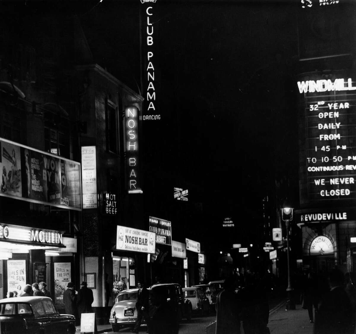 4th November 1963: Great Windmill street in Soho, London with restaurants, cinemas and clubs and also the Windmill Theatre, famous for never closing during WW II.