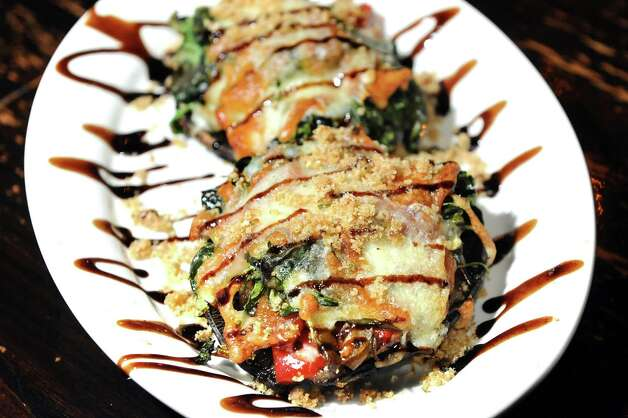 Stuffed portobello mushrooms are stuffed with sauted onions, spinach, roasted red and green peppers and topped with bread crumbs, cheddar cheese and balsamic drizzle on Thursday, Jan. 8, 2015, at O'Briens Public House in Troy, N.Y. (Cindy Schultz / Times Union) Photo: Cindy Schultz / 00030119A