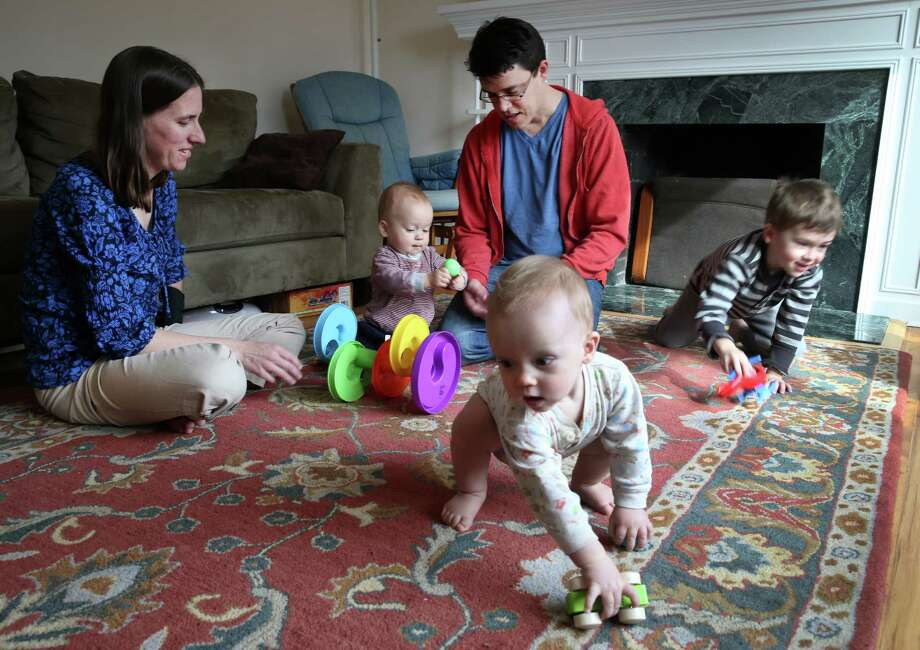 Linnea and Aaron Rich play with their sons in San Rafael, where the vaccine refusal rate is high. Photo: Paul Chinn / The Chronicle / ONLINE_YES