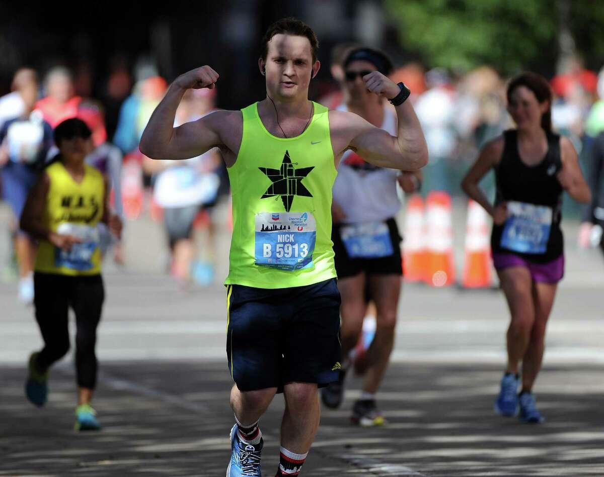 Marathoner Nicholas Lockhart runs towards the finish line during the Houston Marathon, Sunday, January 18, 2015 in Houston.
