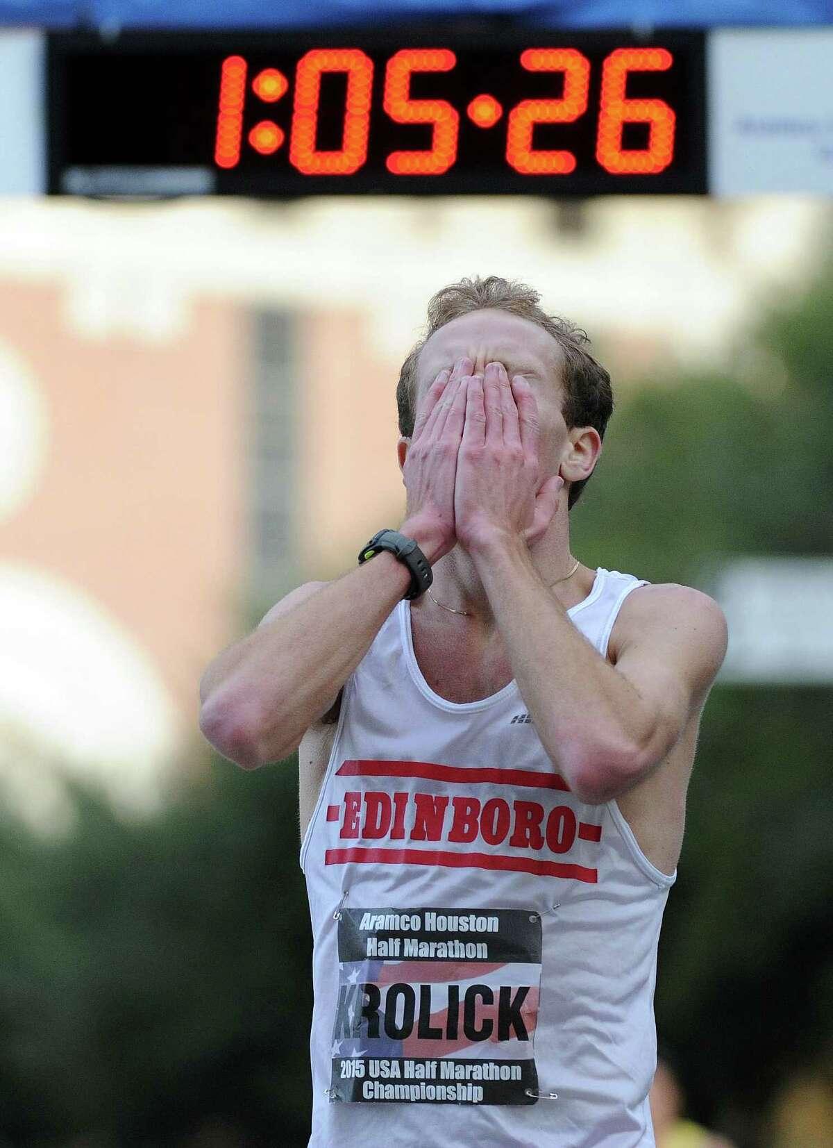 Jacob Krolick reacts after finishing the half-marathon championship during the Houston Marathon, Sunday, January 18, 2015 in Houston.