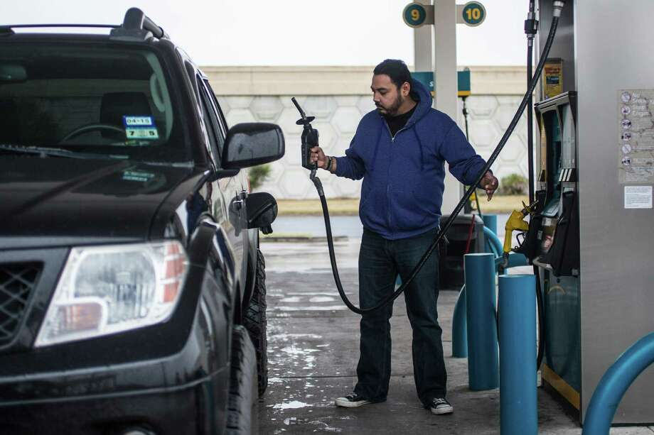 Felix Coronado fuels his vehicle with regular unleaded gasoline in Corpus Christi last week. Those hitting the road on an intrastate trip will find low gas prices throughout Texas. The state's gas-price average of $1.86 puts it among the Top 10 least expensive in the nation, AAA Texas-New Mexico spokesman Doug Shupe said. Photo: Andrew Mitchell /Corpus Christi Caller-Times / Corpus Christi Caller-Times