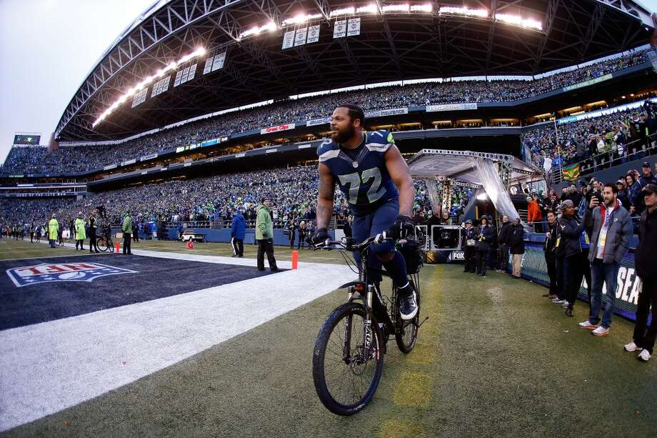 SEATTLE, WA - JANUARY 18: Michael Bennett #72 of the Seattle Seahawks rides a police bike after the Seahawks 28-22 overtime victory against the Green Bay Packers during the 2015 NFC Championship game at CenturyLink Field on January 18, 2015 in Seattle, Washington. (Photo by Otto Greule Jr/Getty Images) Photo: Otto Greule Jr., Getty Images