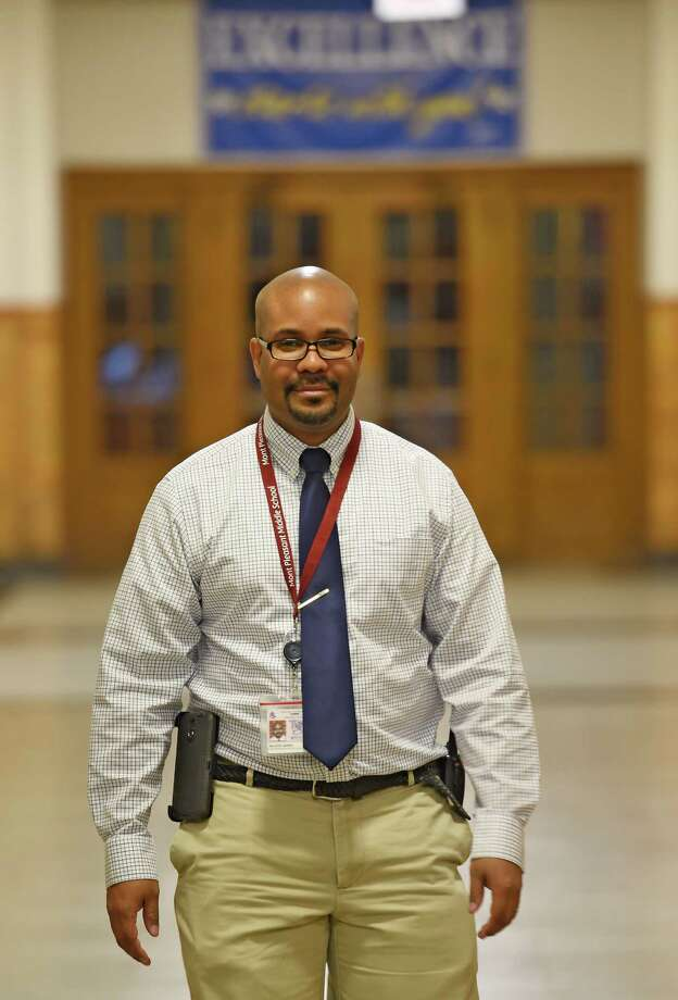 Kiante Jones, has been named principal of Notre Dame-Bishop Gibbons school in Schenectady. Among other previous positions, he has served as principal of Mont Pleasant Middle School, also in Schenectady, N.Y., where he is pictured walking through the schools's hallways on Wednesday morning, Oct. 22, 2014.  (Skip Dickstein/Times Union) Photo: SKIP DICKSTEIN / 00029164A