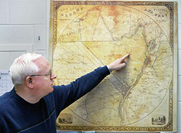 Colonie town historian Kevin Franklin points out highlights of an 1851 Sidney map of Albany, Troy and vicinity in his office Wednesday Jan. 14, 2015, in Colonie, NY.  (John Carl D'Annibale / Times Union) Photo: John Carl D'Annibale / 00030198A