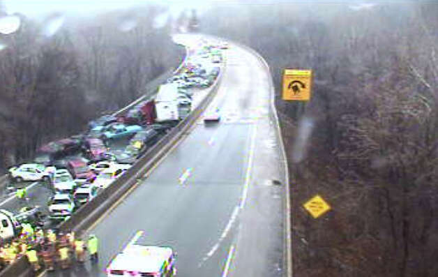 In this image provided by PennDOT, more than 20 cars are piled up on I-76 in Philadelphia after freezing rain on Sunday, Jan. 18, 2015. Slick roads caused a number of crashes, including collisions that also closed parts of Interstates 95 and 476 in and around Philadelphia. (AP Photo/PennDOT) ORG XMIT: NY110 / PennDOT