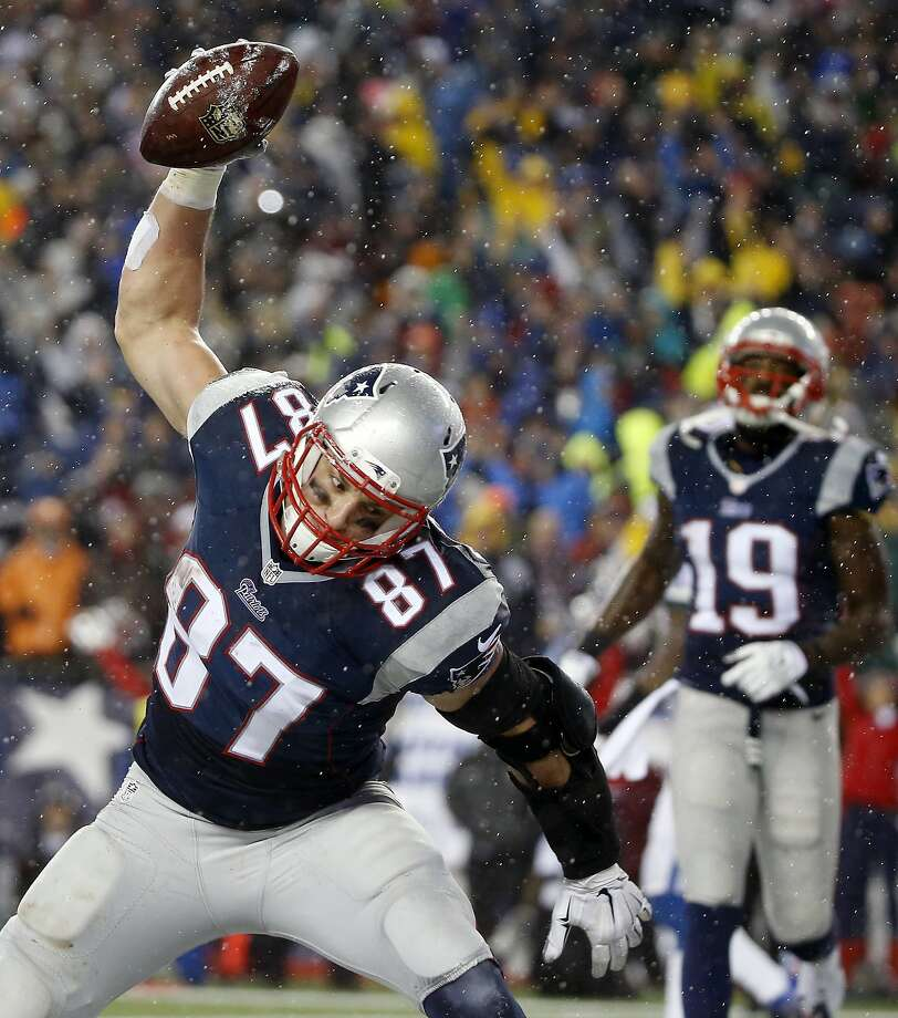 New England Patriots tight end Rob Gronkowski (87) spikes the ball after catching a five-yard touchdown pass during the second half of the NFL football AFC Championship game against the Indianapolis Colts Sunday, Jan. 18, 2015, in Foxborough, Mass. (AP Photo/Elise Amendola) Photo: Elise Amendola, Associated Press