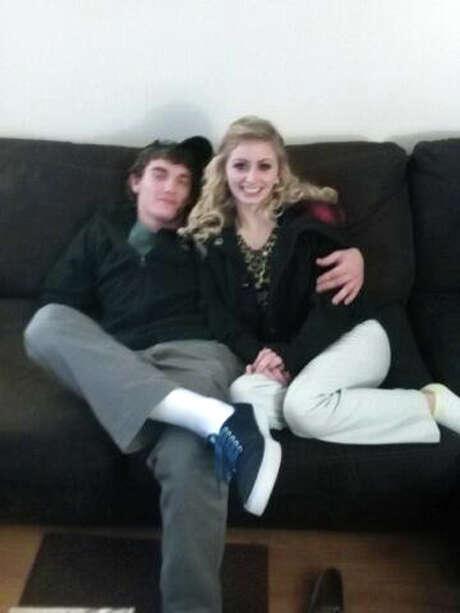 Dalton Hayes, 18, and his 13-year-old girlfriend, Cheyenne Phillips, snuggle. Photo: Tammy Martin /Associated Press / Tammy Martin