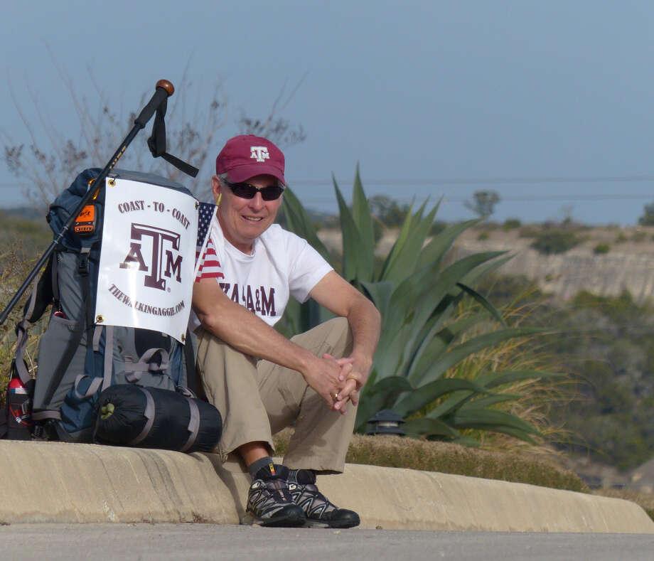 Retired Air Force Col. John Ball plans to walk from San Diego, Calif. to Daytona Beach, Fla. starting on March 1. Photo: Billy Calzada, San Antonio Express-News /  San Antonio Express-News