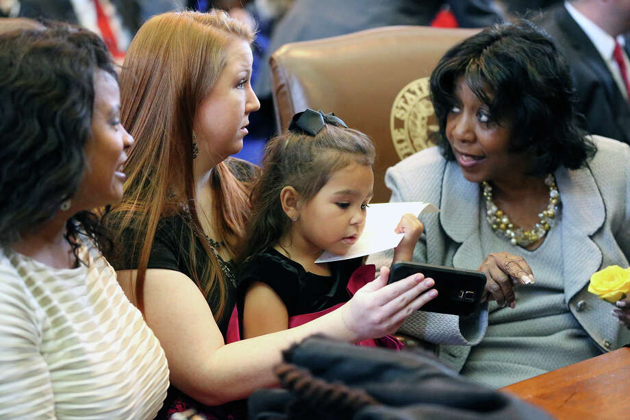 Rep. Ruth Jones McClendon chats with granddaughter Maliyah Jones, on lap of mom Vanessa Jones, and daughter Angela McClendon Johnson (left) during the opening-day ceremonies at the state Legislature. Photo: Tom Reel / San Antonio Express-News