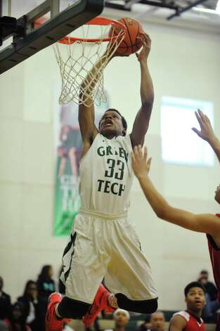 Anquan McLean of Green Tech Charter School slam dunks the ball on his teams first possession during their game against Niagara Catholic on Sunday, Jan. 18, 2015, in Albany, N.Y.  (Paul Buckowski / Times Union) Photo: Paul Buckowski / 00030251A