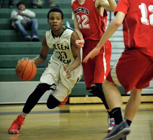 Anquan McLean of Green Tech Charter School drives to the basket during their game against Niagara Catholic on Sunday, Jan. 18, 2015, in Albany, N.Y.  (Paul Buckowski / Times Union) Photo: Paul Buckowski / 00030251A