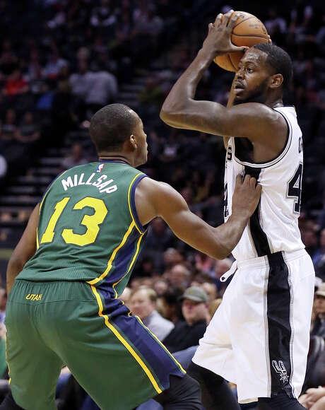 San Antonio Spurs' JaMychal Green looks to pass around Utah Jazz's Elijah Millsap. Green made his Spurs debut after signing a 10-day contract Sunday. Photo: Edward A. Ornelas /San Antonio Express-News / © 2015 San Antonio Express-News