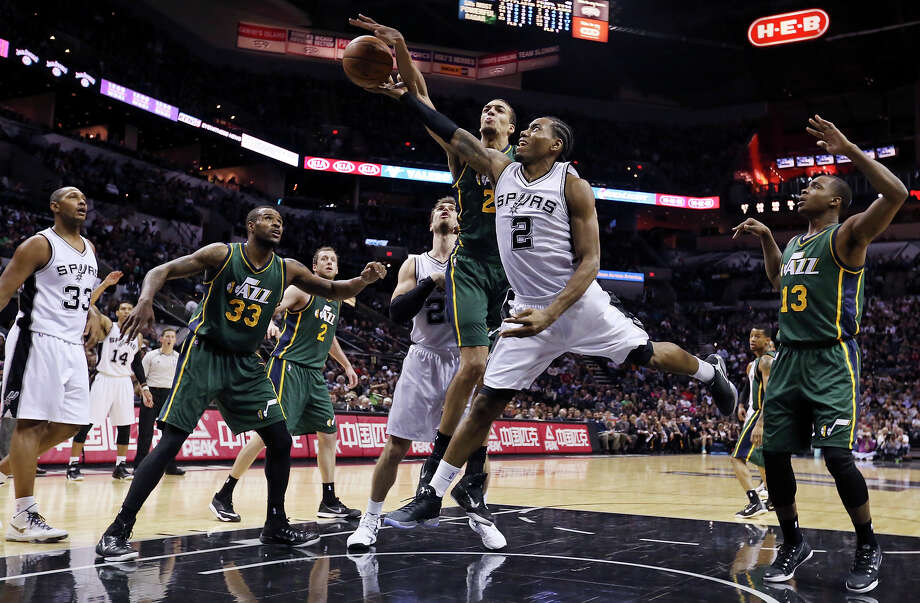 The Spurs' Kawhi Leonard shoots around the Utah Jazz's Rudy Gobert during the second half on Jan. 18, 2015 at the AT&T Center. The Spurs won 89-69. Photo: Edward A. Ornelas /San Antonio Express-News / © 2015 San Antonio Express-News